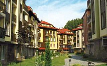Зимна ваканция в Банско след 24.02 с топъл басейн със закуска и вечеря за двама в Хотел Божур
